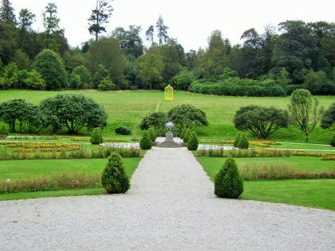 Formal gardens with sundial and birdcage in axis